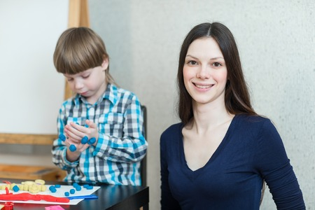 teaching material: Mother and son at home play with molded clay and play together Stock Photo