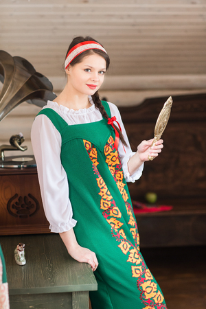 kokoshnik: Beautiful woman portrait in russian style traditional dress.