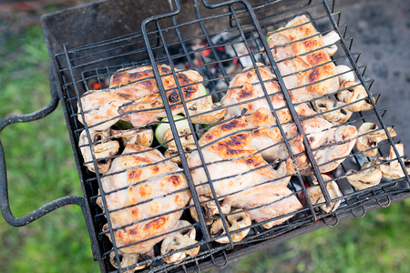 quarters: Closeup of barbecue chicken quarters on a burning grill