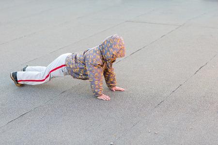 pushup: Caucasian preschooler boy making pushup outdoors sunset Stock Photo