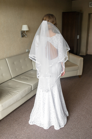 luxury hotel room: Beautiful bride in luxury hotel room. Young gorgeous bride in interior