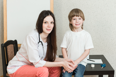 children's doctor: A child on reception at the doctor. Treatment in childrens hospitals.