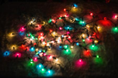 multicolored defocused bokeh blurry lights christmas lights festive background stock photo 65891353 - Blurry Christmas Lights