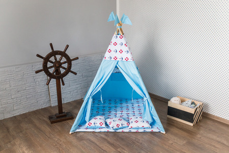 Bright baby room interior with a teepee