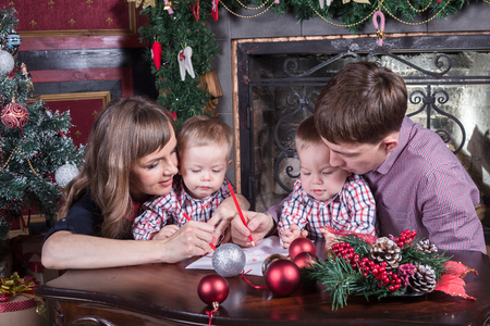 Christmas. Young family has a rest. The room is festively decorated. Stock Photo
