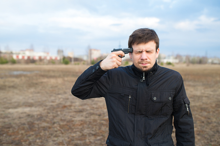 Man trying to commit suicide with a gun Stock Photo