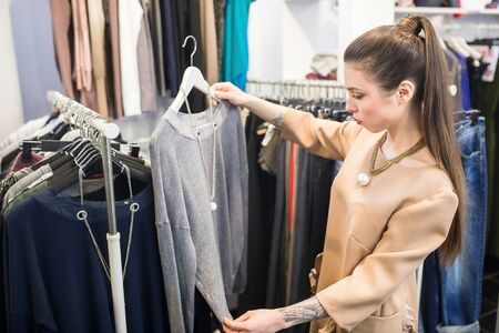 shopper: Shopper woman choosing clothes