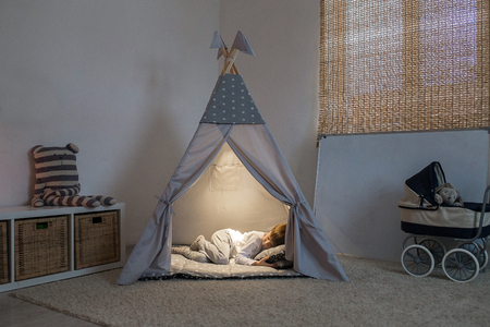boy sleeps in the teepee 스톡 콘텐츠