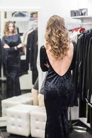 fitting in: woman in fitting room at a clothing store Stock Photo