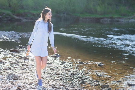 woman walking on rocks Stock Photo