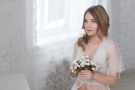 Brides morning in a bright room. Stock Photo