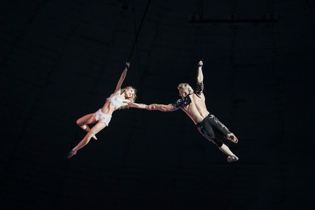 Stunt aerialists in the circus. Love, danger, and romance concept. 版權商用圖片