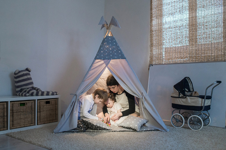 tipi: Young happy mother playing with the children