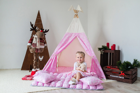 Little girl playing in a tent. Stock Photo