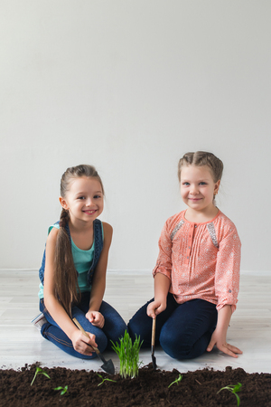 undertaking: Children and symbol of Earth Day in the white room