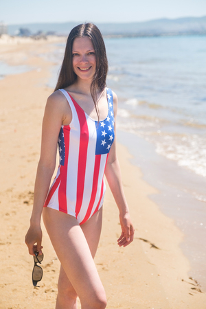 Portrait of a woman patriot of the USA on the ocean Stock Photo