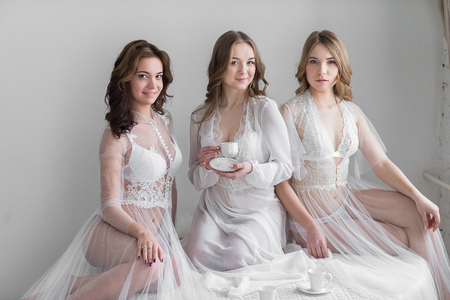 Three sexy girls brides in lingerie Stock Photo