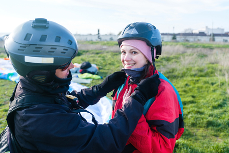 Preparation of tandem paraglider for the first flight Stock Photo