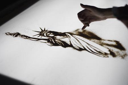 Animation de sable pour la fête de l'indépendance aux États-Unis Banque d'images - 79877170