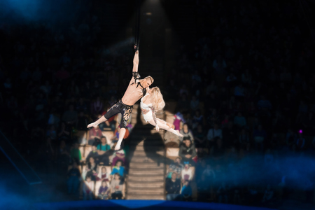 Stunt aerialists in the circus. Love, danger, and romance concept. Stock Photo