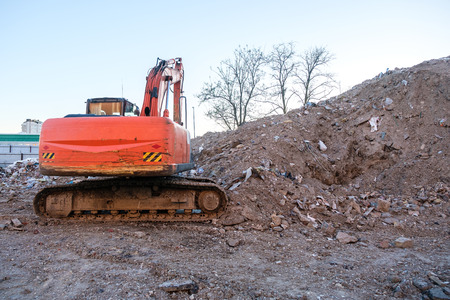 aggregates: Excavator working on the excavation works of a road, moving rock and earth
