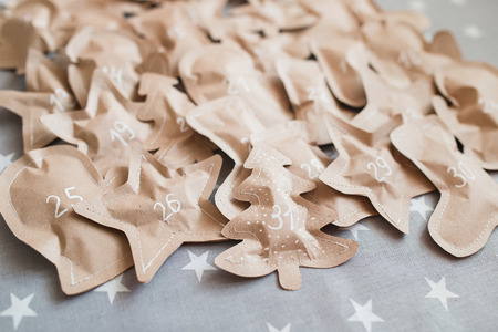 Crafted christmas presents wrapped in paper bags. December 31. Stock Photo