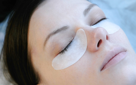 Beauty treatment. lash lamination. Closeup face.
