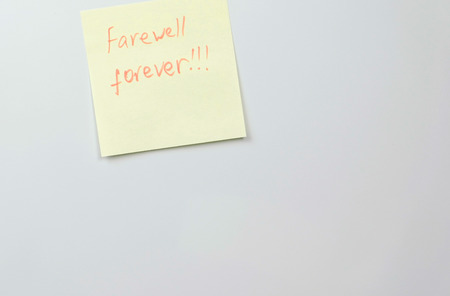 Note on yellow sticker paper sheets with words farewell forever