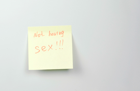 Note on yellow sticker paper sheets with words not having sex