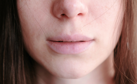Closeup womans lips and freckles on face