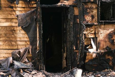 Burned down private wooden house outdoor park. Reklamní fotografie