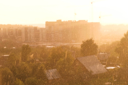 Heavy rain with sun. Beautiful view of the city.