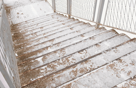 Staircase covered in snow in winter day. Standard-Bild - 112547310