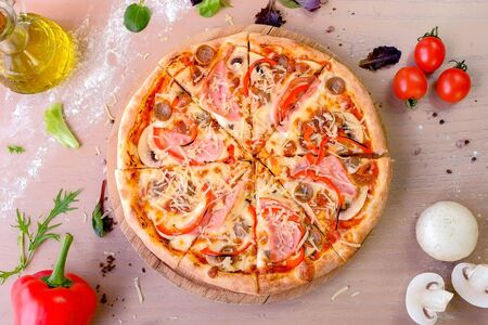 Bacon, mushroom and cheese pizza on wooden board. Close-up top view Imagens