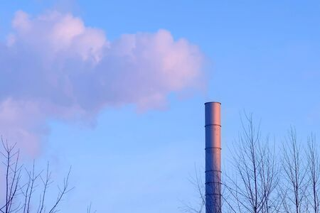 White smoke from the pipes of plant on the outskirts of industrial district Imagens