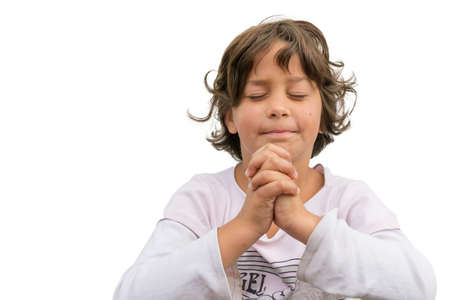 Little child devotional, gypsy girl praying in church isolated on white background