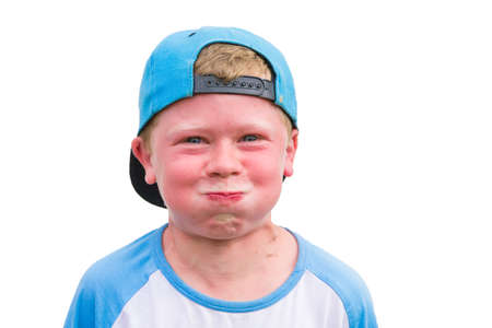 angry kid: Small angry child boy try to hold breath getting red isolated on white background