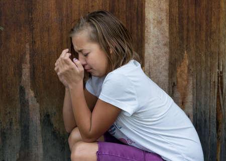 oppressed: Sad forsaken kid crying lonely