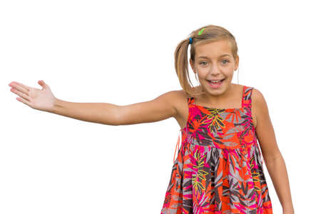 gesticulating: Excited happy child girl pointing somewhere, gesticulating and expressing joy emotions isolated on white background Stock Photo