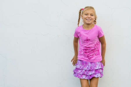 craked: Happy smiling child in front of white craked wall Stock Photo