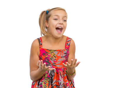 gesticulating: Excited expression of joy, enthusiastic screaming child girl isolated on white background