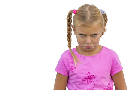 insulted: Sad angry child girl expression portrait isolated on white background Stock Photo