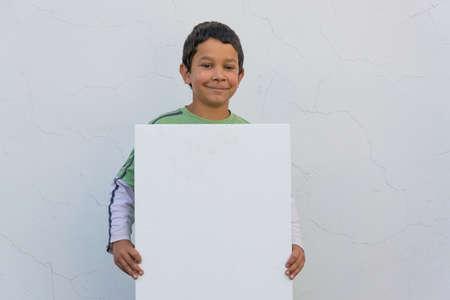 gypsy: Smiling gypsy child boy holding white banner