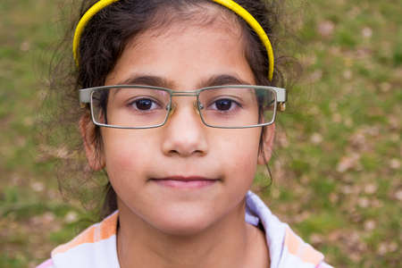funny glasses: Funny gypsy child girl wear too big glasses