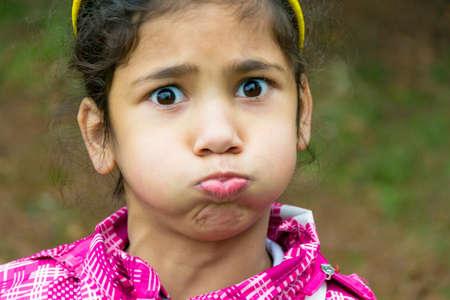 gypsy: Little gypsy girl child holding breath funny portrait