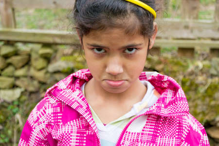 offend: Angry child girl expression closeup portrait Stock Photo