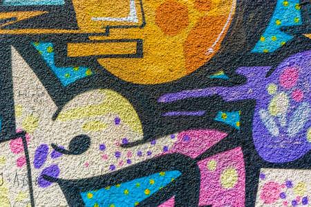 vandalism: Colorful bright graffiti closeup texture background sprayed on wall