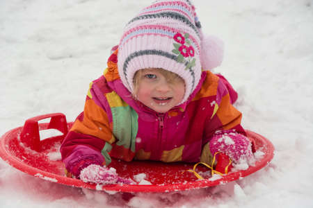 Little toddler play in snow