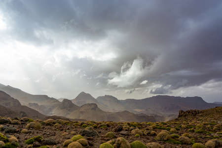 Clouds above mountain ridge in Morocco Antiatlas mountains 写真素材