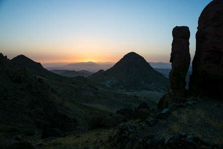 Sunset over Morocco Antiantlas mountains with rock formation silhouette of rocking stone